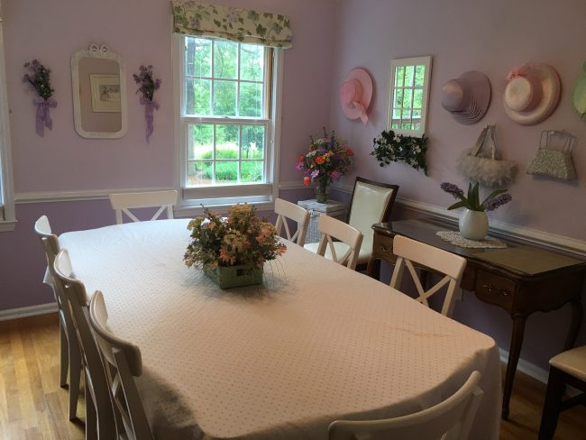 Purple Dining Room right off the foyer seats 6-8. Don a hat and lift your pinky at tea time!