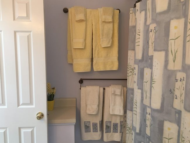 Full shower and tub in the Master Bath with color coordinated towels