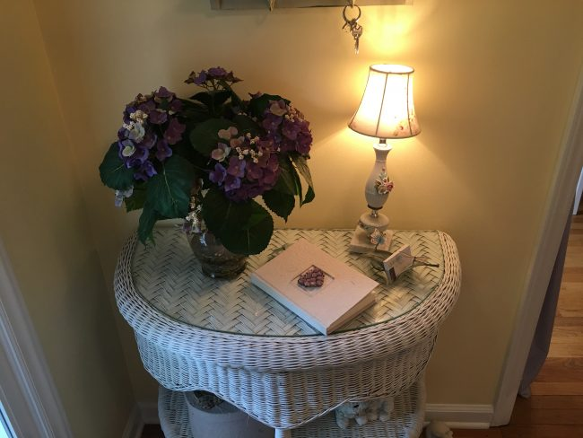 The dainty entry table with guest book.