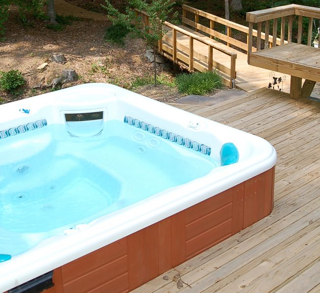 The hot tub is deep and warm.