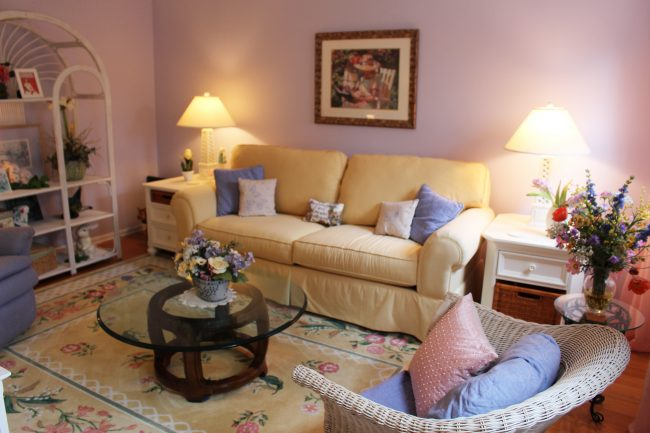 Living room is decorated in soft, soothing pastels.