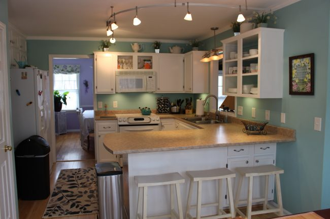 Adjacent to dining room is the kitchen - fully equipped with everything you need including dishwasher, smooth cooktop, convection oven and side-by-side fridge